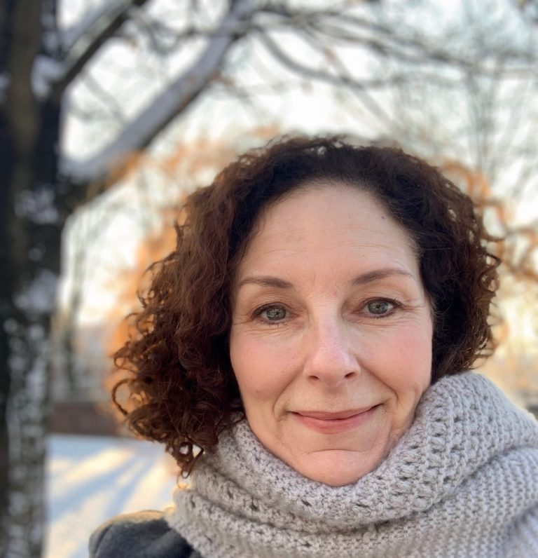 photograph of Dr. Lora Taub, outdoors in winter